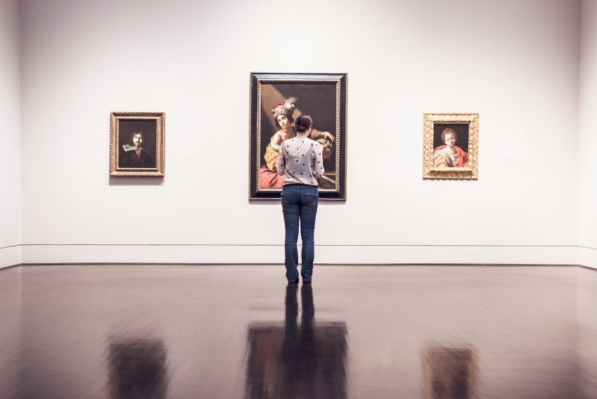 Image of a woman standing in an art gallery