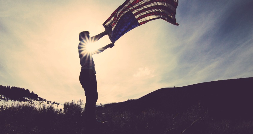 Image of a man holding the American Flag