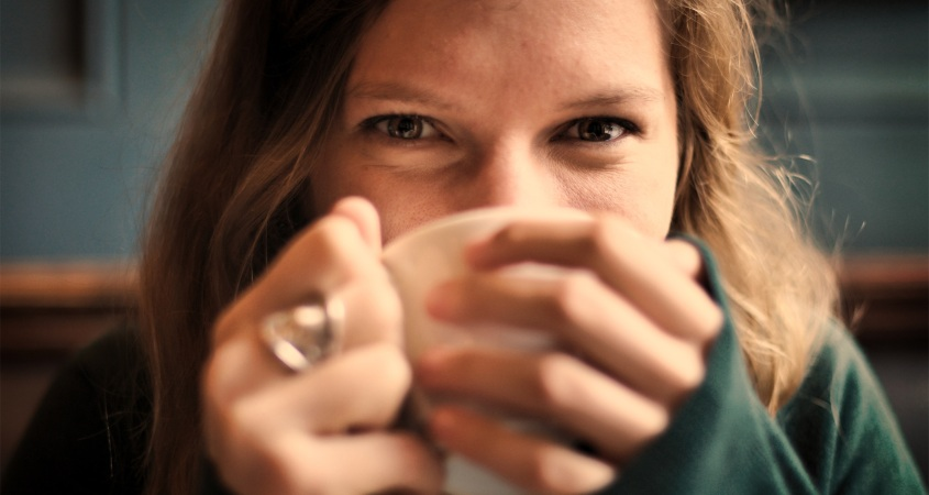 Image of girl drinking coffee.
