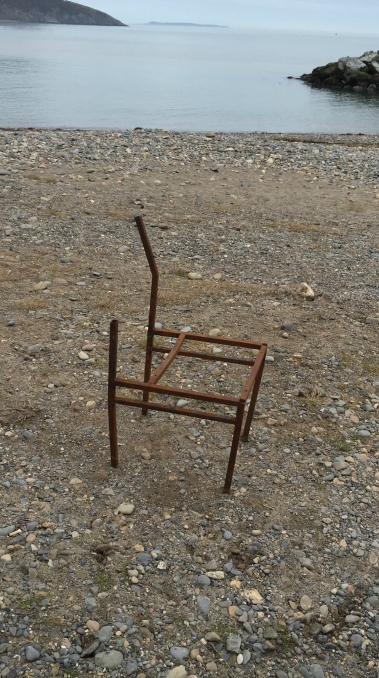 Image of a Rusted chair frame on beach